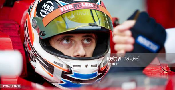 driver greeting his team member - racing driver stock pictures, royalty-free photos & images