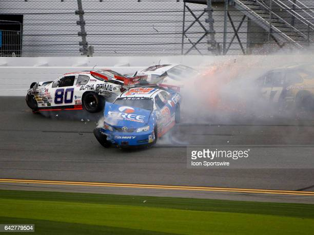 ARCA driver Gus Dean and Casear Bacarella and Sean Corr crash during the ARCA Lucas Oil 200 on February 18 at Daytona International Speedway in...