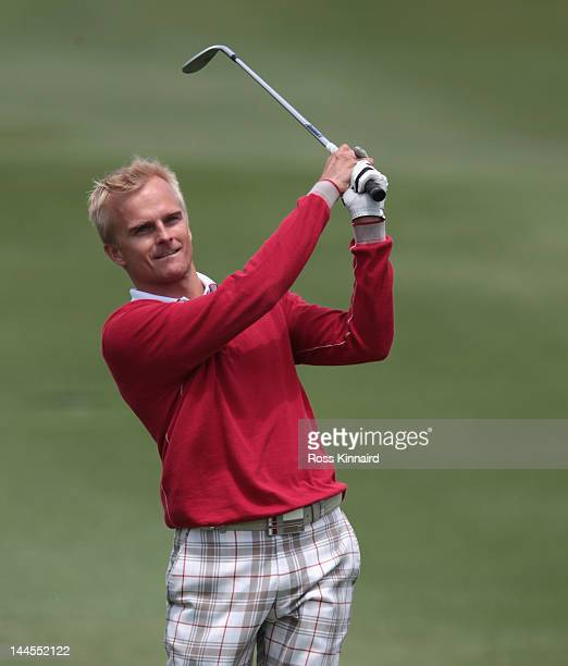 Driver Heikki Kovalainen of Finland in action during the Pro Am event prior to the Volvo World Match Play Championship at Finca Cortesin Golf Club on...