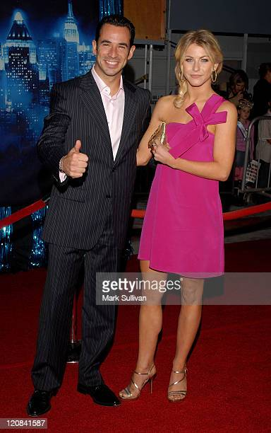 IRL driver Helio Castroneves and actress Julianne Hough arrive at the premiere of 'Enchanted' held in Hollywood California on November 17 2007