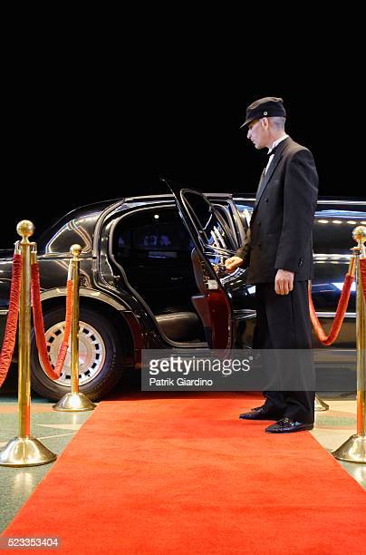 driver holding limo door open - film premiere stock pictures, royalty-free photos & images