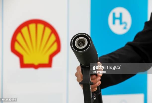 A driver holds a hydrogen fuel pump at Royal Dutch Shell Plc's first UK hydrogen refueling station in Cobham UK on Wednesday Feb 22 2017 Shell...