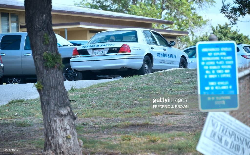 A driver in a School Saftey vehicle makes his way on the campus of El Camino High School in Whittier, California on February 21, 2018 where a threat by a student overheard by a school safety officer may have stopped a shooting. Authorities were alerted, leading to the finding of a cache of weapons in the teenager's home. Marino Chavez, a security officer at El Camino High School in Whittier, southeast of Los Angeles, helped thwart a potential shooting February 16, 2018, two days after the deadly Valentines Day shooting in Florida that left 17 people dead, authorities said February 21. Chavez said during a news conference he overheard a 17-year-old student say he was going to launch an attack within three weeks. Chavez stopped and questioned the student, who claimed it was a joke, he said. / AFP PHOTO / Frederic J. BROWN