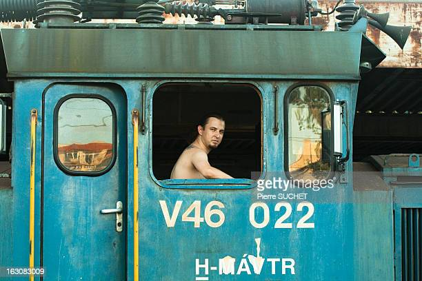 Driver in his locomotive leaving Nyugati station. Budapest - Hungary . 2009