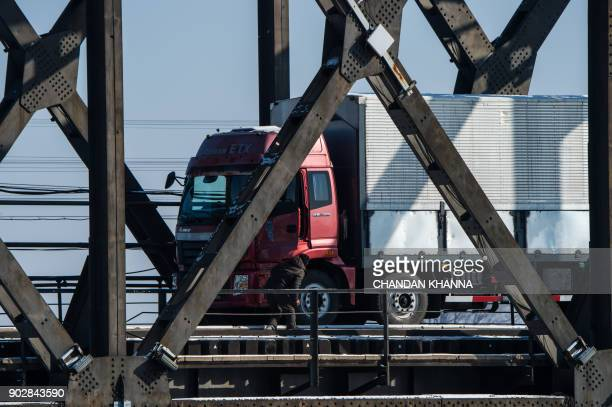 A driver inspects a truck as he returns over the Friendship Bridge from the North Korean town of Sinuiju to the Chinese border city of Dandong in...