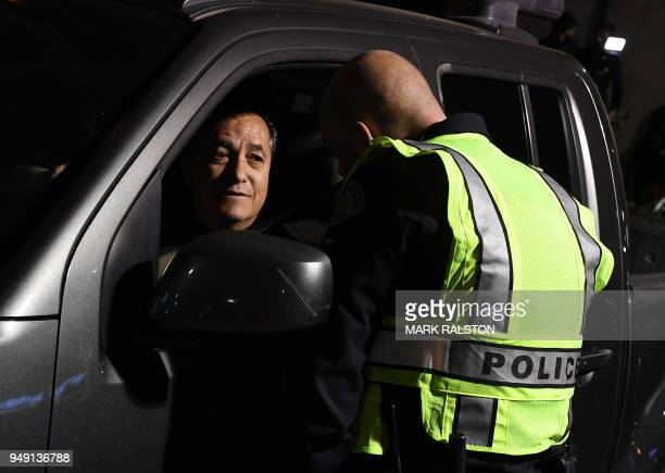 A driver is questioned at a LAPD police DUI checkpoint in Reseda Los Angeles California on April 13 2018 Pot may be legal in eight US states and the...