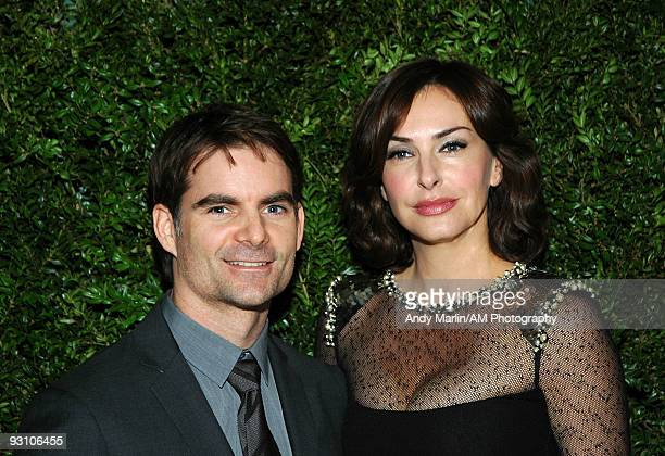 NASCAR driver Jeff Gordon and his wife model Ingrid Vandebosch pose for a photo at the CFDA/Vogue Fashion Fund Awards at Skylight Studio on November...