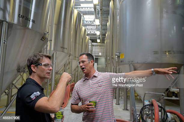 NASCAR driver Jeff Gordon Gordon left gets a tour of the Dogfish Head brewery by founder Sam Calagione Gordon made a PR stop in Delaware accompanied...