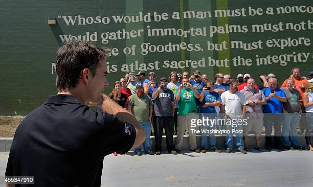 NASCAR driver Jeff Gordon left prepares to poses for photos with a group of workers at the Dogfish Head Brewery as makes a PR stop in in Milton DE...