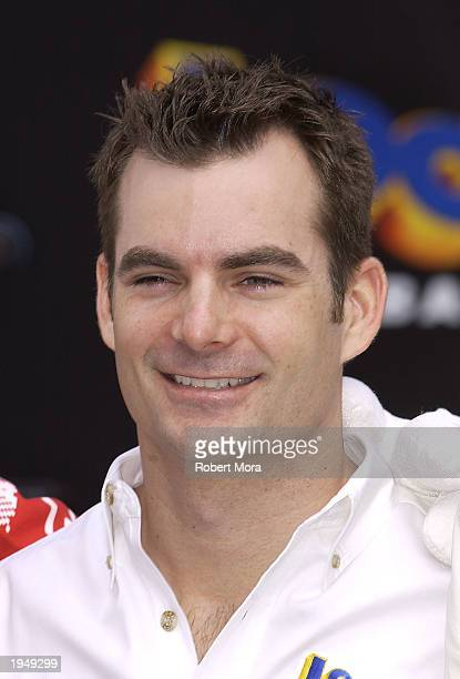 NASCAR driver Jeff Gordon poses for a photograph at the Looney Tunes Back in Action Race Car Pace Car and Spy Car unveiling at Warner Brothers...