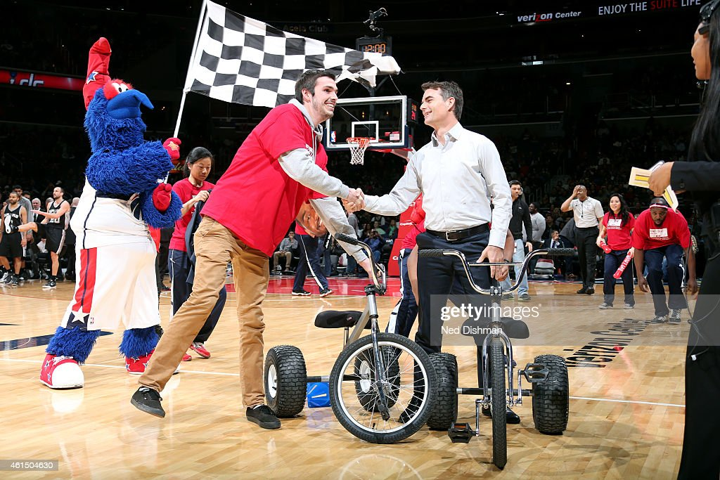 NASCAR driver Jeff Gordon promotes The Great American Race with the Road to the DAYTONA 500 Tour during a game between the San Antonio Spurs and Washington Wizards on January 13, 2015 at Verizon Center in Washington, DC.