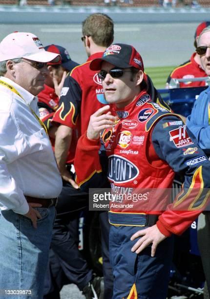 NASCAR driver Jeff Gordon talks with his car owner Rick Hendrick prior to the start of the 2005 Daytona 500 on February 20 2005 at the Daytona...