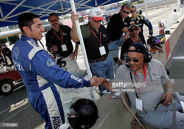 Driver Jesus Hernandez shakes hands with Wendell Scott, Jr., after his qualifying lap during the NASCAR Drive for Diversity Combine at South Boston...