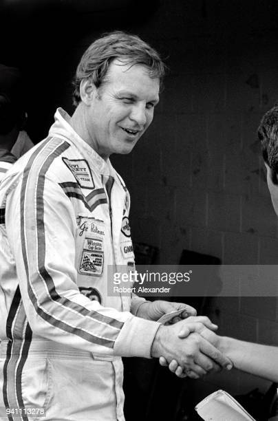NASCAR driver Joe Ruttman shakes hands with a reporter prior to the start of the 1983 Daytona 500 stock car race at Daytona International Speedway in...