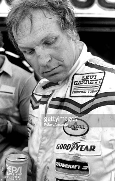 NASCAR driver Joe Ruttman talks with reporters after competing in the 1983 Daytona 500 stock car race at Daytona International Speedway in Daytona...