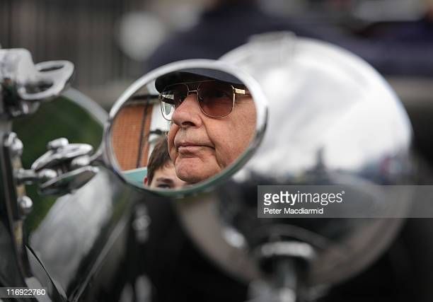Driver John Lawson is reflected in the mirror of his 1934 Lagonda M45 Open Tourer at The Brooklands Double Twelve Motorsport Festival on June 18 2011...
