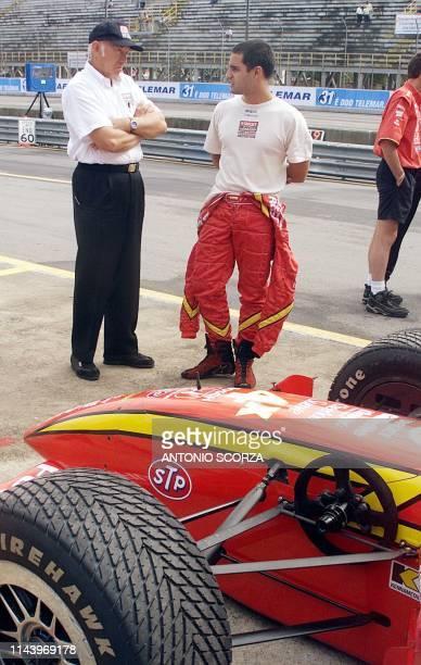 CART driver Juan Pablo Montoya speaks to his coach at the Emerson Fittipaldi racetrack in Sao Paulo El piloto colombiano de Formula CART Juan Pablo...