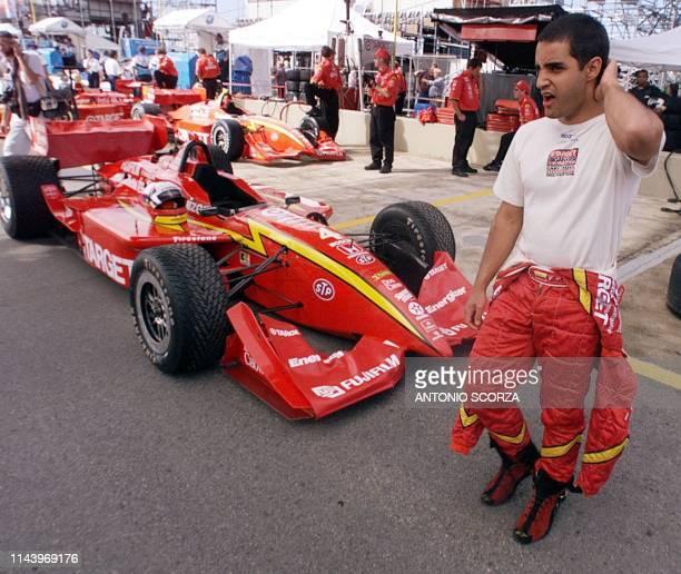 CART driver Juan Pablo Montoya walks in the pits before a training run in Sao Paulo El piloto colombiano de Formula CART Juan Pablo Montoya del...