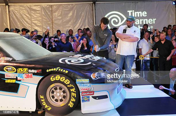 NASCAR driver Kasey Kahne and Charm City Cakes Chef Duff Goldman attend the unveil of Kasey Kahne's No 5 Time Warner Cable Chevrolet at Hendrick...