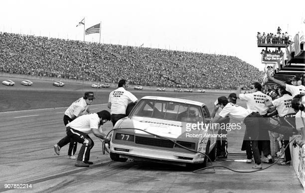 NASCAR driver Ken Ragan's crew change tires and add fuel to the racecar during a green flag pit stop during the 1984 Daytona 500 NASCAR race at...