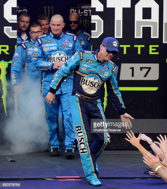 NASCAR driver Kevin Harvick reaches out to slap hands with fans during driver introductions prior to the NASCAR Monster Energy AllStar Race on May 20...