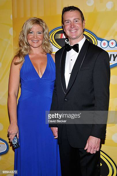 Driver Kurt Busch and wife Eva Busch pose on the red carpet for the NASCAR Sprint Cup Series awards banquet during the final day of the NASCAR Sprint...