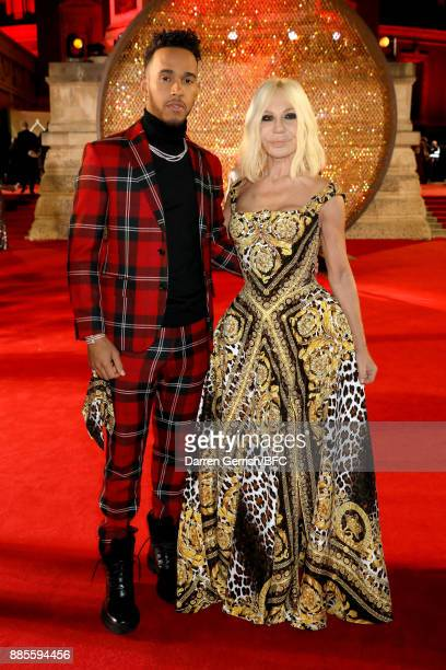 F1 driver Lewis Hamilton and designer Donatella Versace attend The Fashion Awards 2017 in partnership with Swarovski at Royal Albert Hall on December...