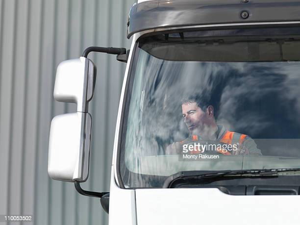 Driver looking in truck mirror