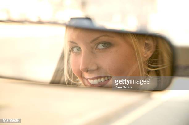 Driver Looking into Rear-view Mirror