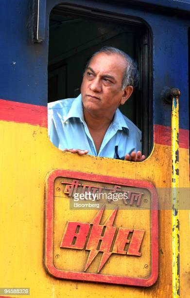 A driver looks out of a window of an AC/DC locomotive train engine manufactured by Bharat Heavy Electricals Limited which is used by Central Railways...