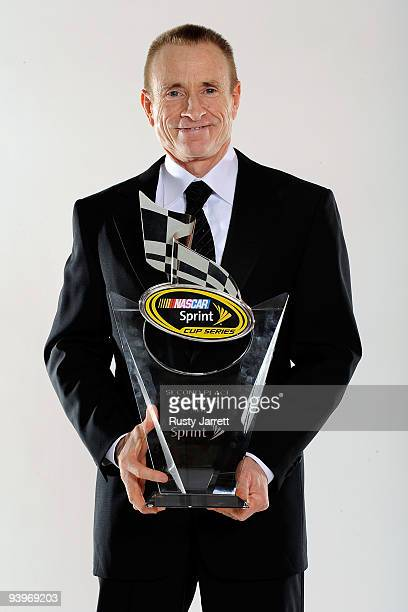 Driver Mark Martin poses with the 2nd place award during the NASCAR Sprint Cup Series awards banquet during the final day of the NASCAR Sprint Cup...