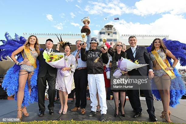 Driver Mark Purdon celebrates with owners of Lazarus after winning Race 10 the New Zealand Trotting Cup during New Zealand Trotting Cup Day at...