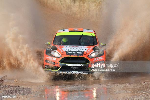 Driver Martin Prokop of Czech Republich and codriver Jan Tomanek of Czech Republich steer their Ford Fiesta RS WRC at 'Arena motocross' of Ittiri...