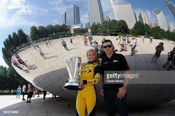 NASCAR driver Matt Kenseth and Miss Sprint Cup Brooke Werner stand next to The Cloud Gate in Millennium Park on September 11 2013 in Chicago Illinois