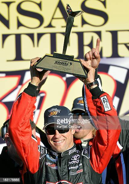 Driver Matt Kenseth holds up the trophy after winning the Nationwide Series race on Saturday October 5 at the Kansas Speedway in Kansas City Kansas