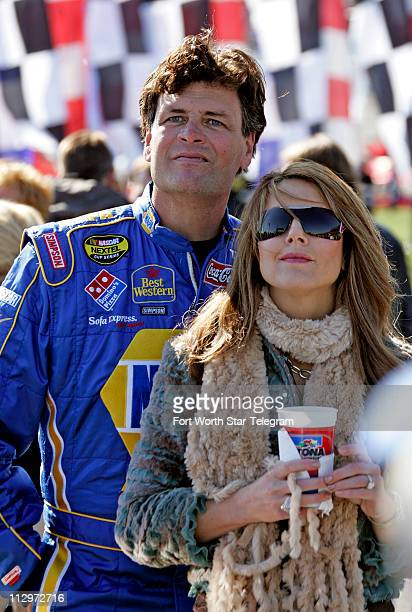 Driver Michael Waltrip and his wife Buffy watch the prerace show before the NASCAR Nextel Cup Daytona 500 at Daytona International Speedway in...