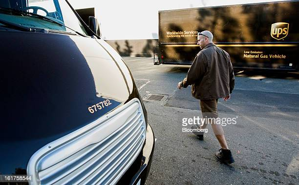 Driver Mike Eastus inspects an allelectric vehicle before heading out for the day at the United Parcel Service distribution center in Sacramento...