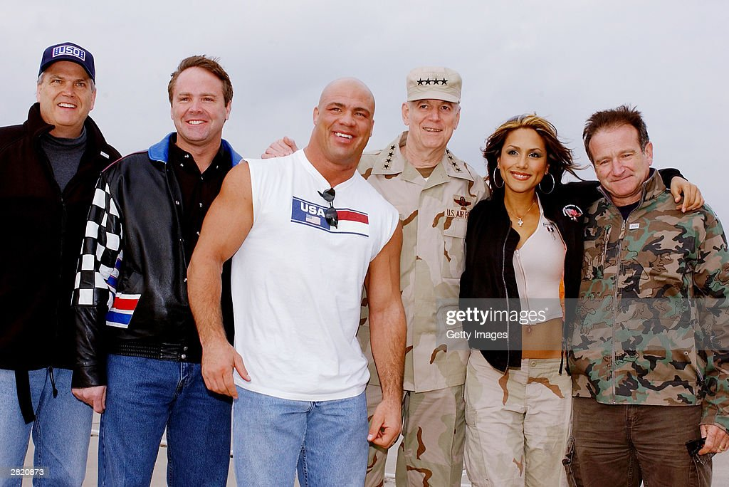 NASCAR driver Mike Wallace, World Wrestling Entertainment star Kurt Engle, Chairman of the Joint Chiefs of Staff Gen. Richard Myers, Model Leeann Tweeden and Actor/Comedian Robin Williams pose before they entertain the troops during the United Service Organizations (USO) tour at Baghdad International Airport on December 16, 2003.