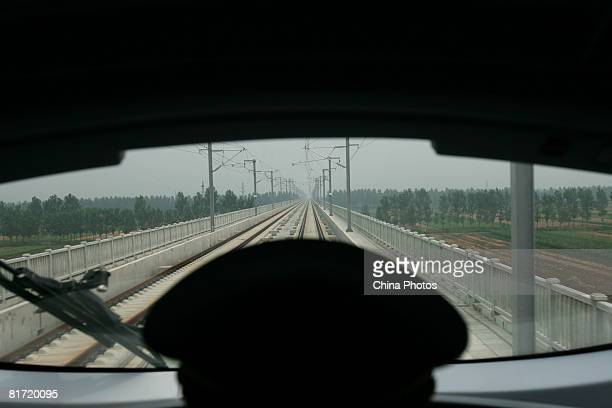 A driver monitors a CRH 'bullet train' leaving the Beijing South Railway Station under reconstruction on June 26 2008 in Beijing China The station...
