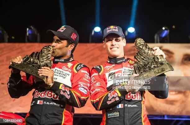 TOPSHOT Driver Nasser AlAttiyah of Qatar and codriver Matthieu Baumel of France celebrate on the 2019 Dakar Rally podium in Lima on January 17 2019