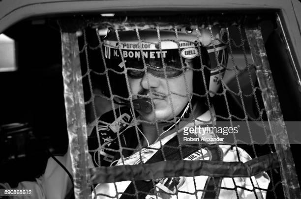 NASCAR driver Neil Bonnett sits behind the wheel of his race car prior to the start of the 1980 Daytona 500 stock car race at Daytona International...