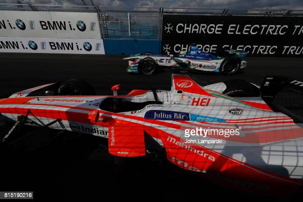 Driver Nick Heidfeld's Machindra Racing car stands disabled on the track after it broke an axle during the Formula E Qualcomm New York City ePrix on...