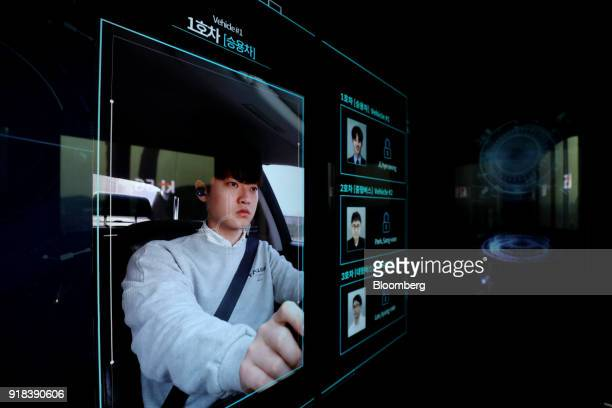 A driver of another vehicle is displayed on a monitor onboard an autonomous 5G connected bus operated by KT Corp during a media event in Gangneung...