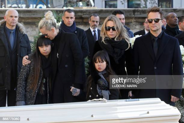Driver of late French singer Johnny Hallyday Patrick Roussel his son David Hallyday daughter Laura Smet wife Laeticia their daughters Jade and Joy...