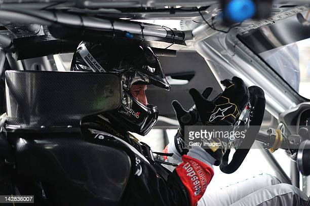 A driver of team Black Falcon Mercedes SLS AMG Gt3 sits in his car during the Blancpain GT Endurance test day one at Autodromo di Monza on April 13...