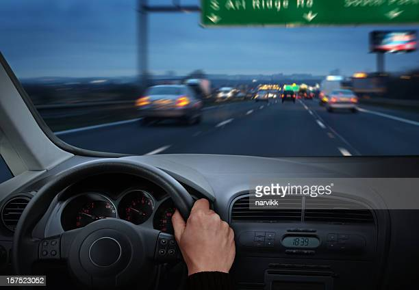 Driver on the Highway by Twilight