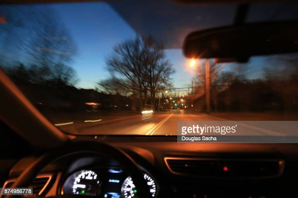 driver on the highway by twilight - dashboard camera point of view stock photos and pictures