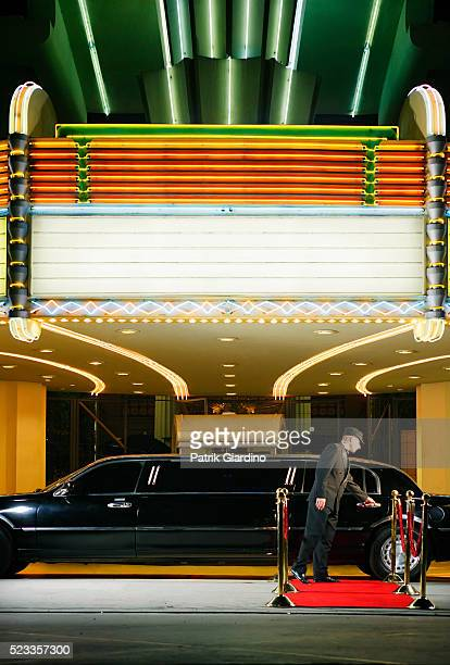 driver opening limo door at premiere - film premiere stock pictures, royalty-free photos & images