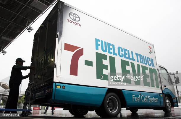 A driver opens the back door of a Toyota Motor Corp fuel cell truck during a news conference jointly held by Toyota and SevenEleven Japan Co in Tokyo...