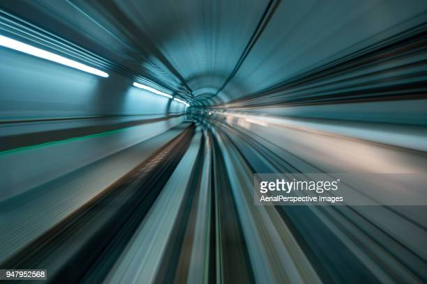 Driver POV over single metro tunnel as seen from a driverless metro train